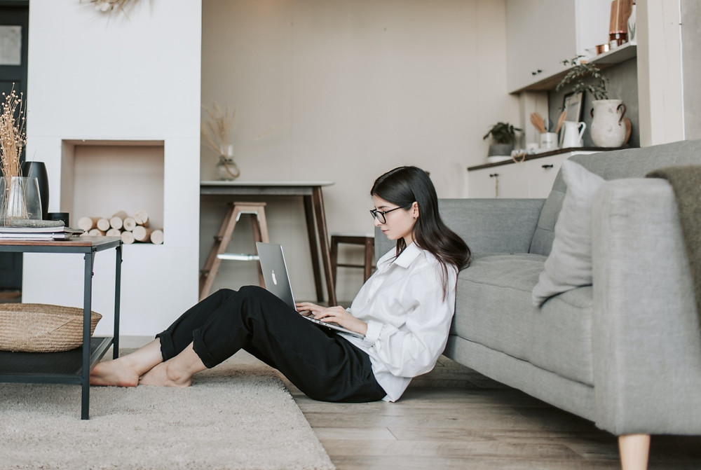 Businesswoman works from home.  A work-from-home career requires that you increase the amount of cleaning in your home.