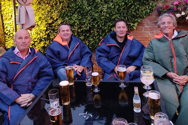 Group of men sat at The Feathers in Laleham in their Sittingsuits