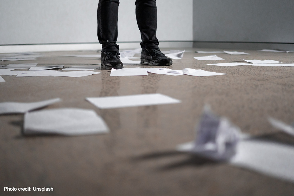 discarded plans and papers all over the floor