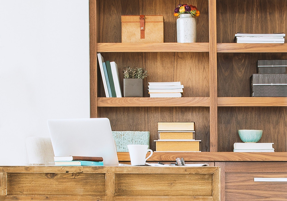 Office space with bookcase behind desk