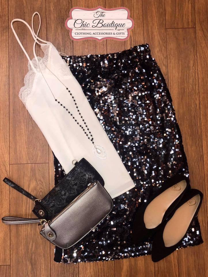 Dressy skirt and top with shoes and purses.