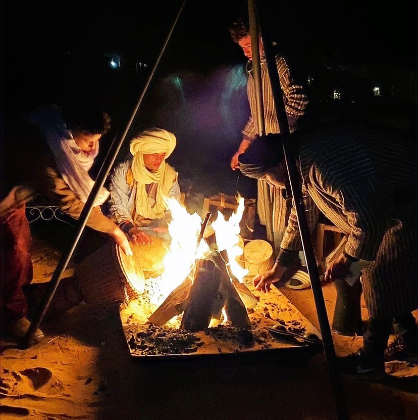 Morocco Berber People and camp fire in Merzouga Paradise Luxury camp at heart of Sahara desert