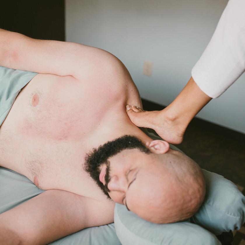 Upper back massage using feet at NC barefoot massage training center