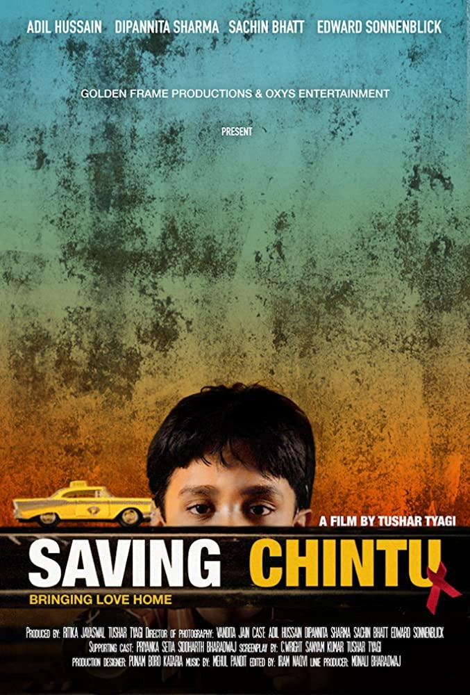 Saving Chintu. A young Indian boy and a yellow toy and an AIDS red ribbon.  taxi.