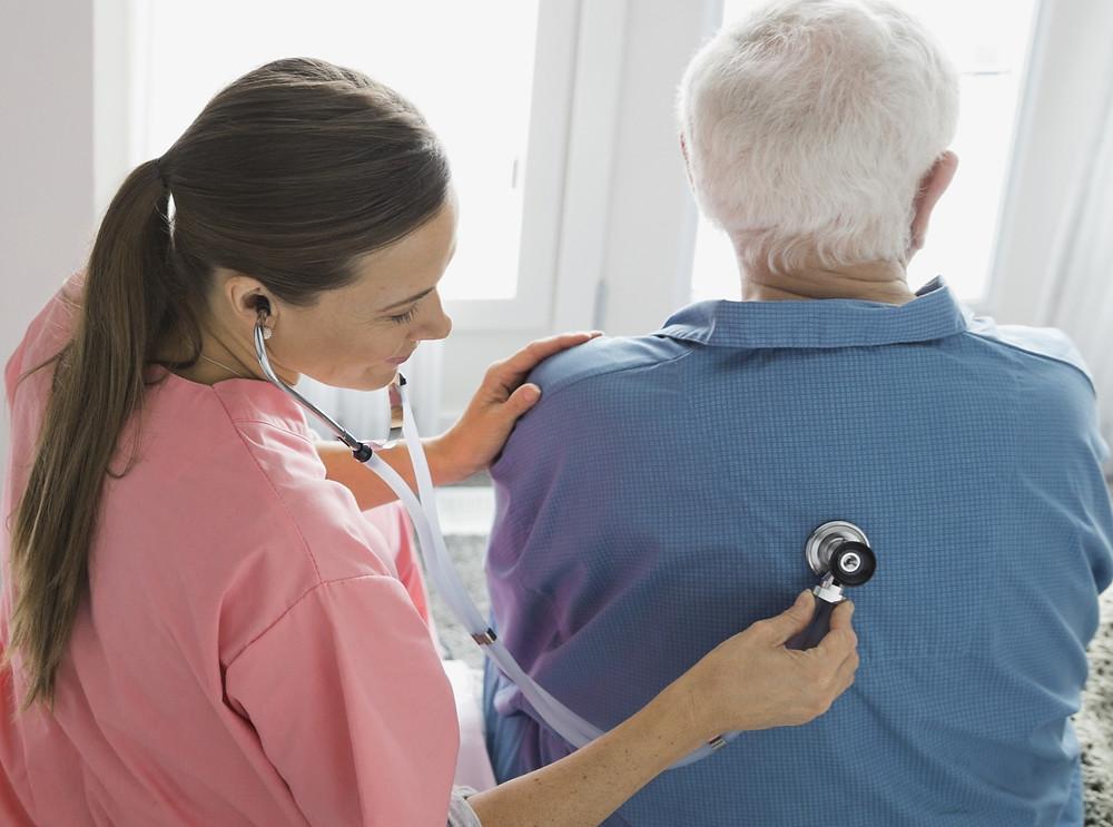 Nurse caring for a senior citizen in a nursing home