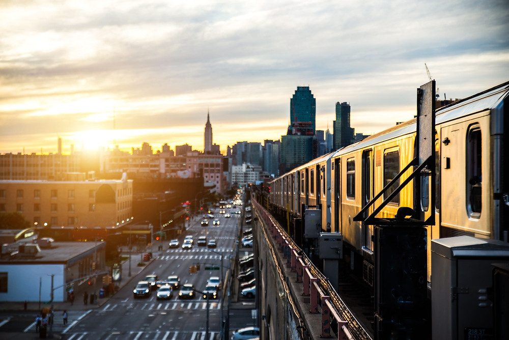 Subway riding into a gorgeous sunset in Manhattan, New York.