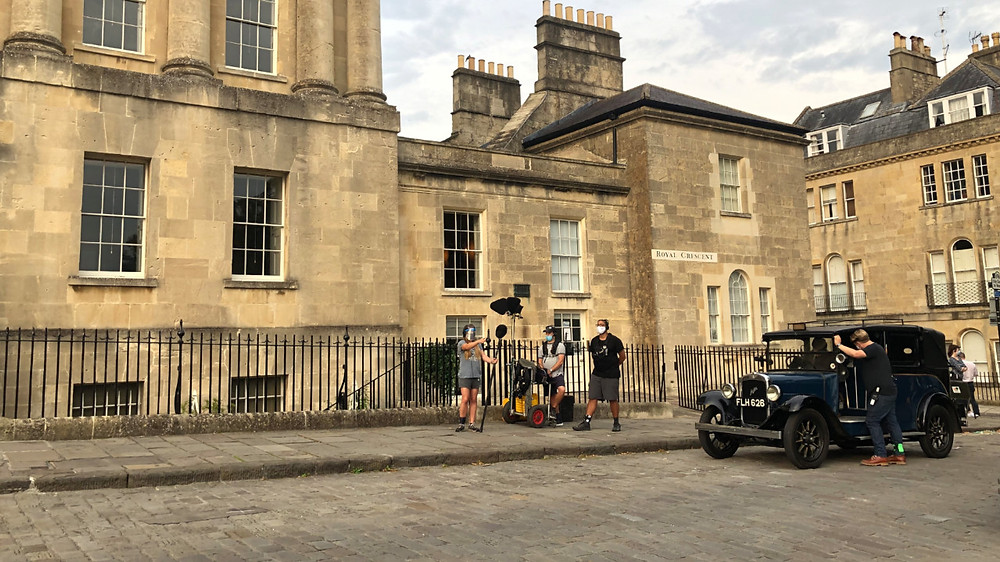 On the set of Bridgerton in Bath, England, filming a car and hotel scene