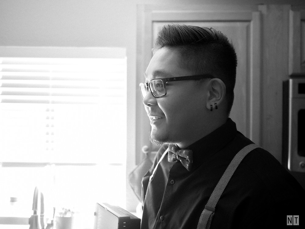 Friend of the groom smiling while getting ready