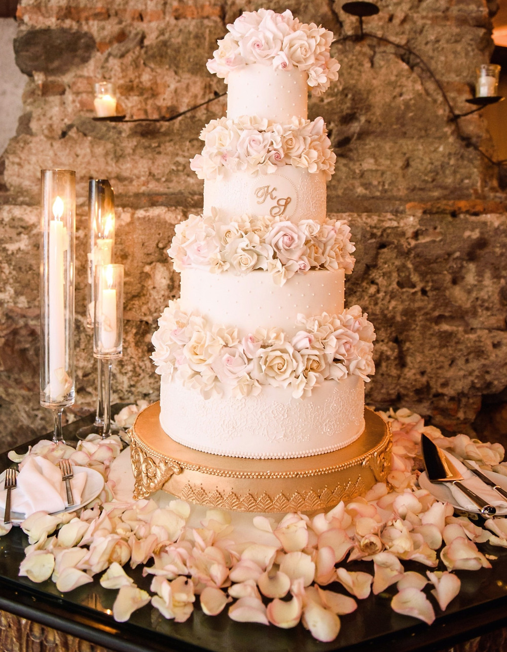4-tier-wedding-cake-decorated-with-pale-pink-rose-petals