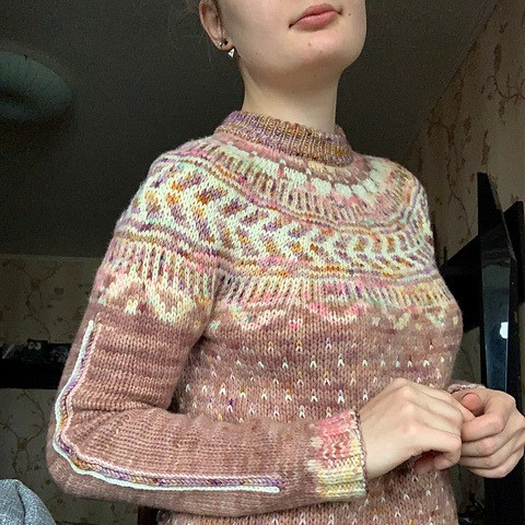 A dusty mauve and cream colourwork sweater