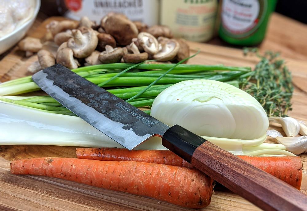 shiitake mushrooms, scallions, thyme, yellow onion, garlic, celery and carrots