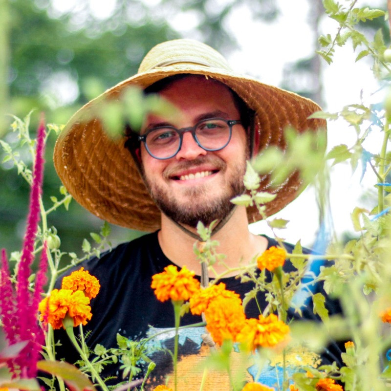 mitchell provensal in flowers at Baton Roots Community Farm at BREC Howell Park