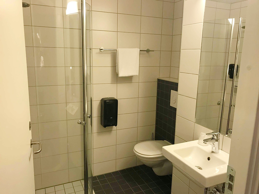 Bathroom inside single room in Citybox Oslo, Norway