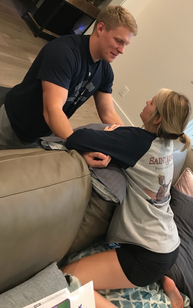 Dad talks mom through hands and knees push practice