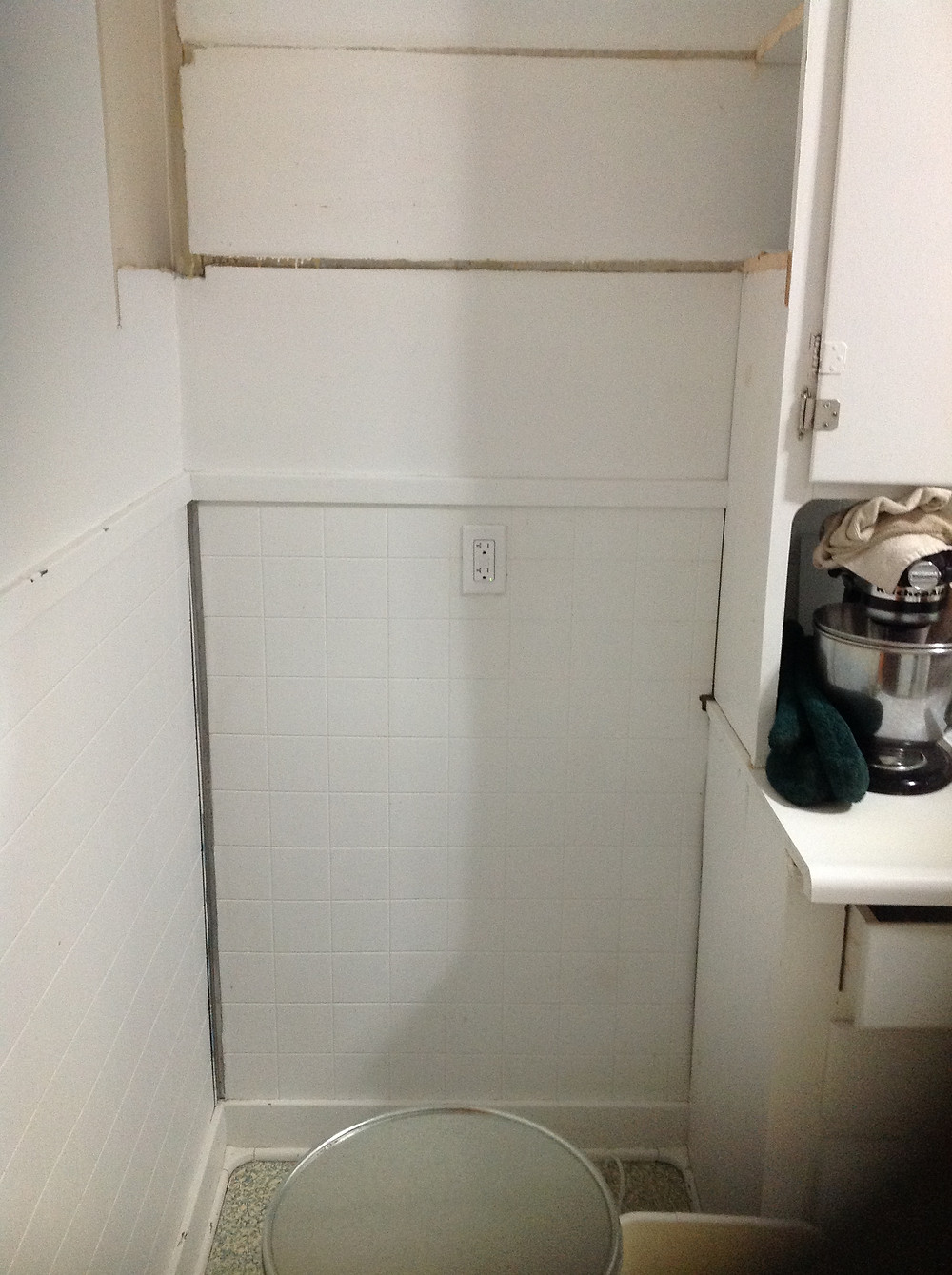 Refrigerator spot with no cupboards above.