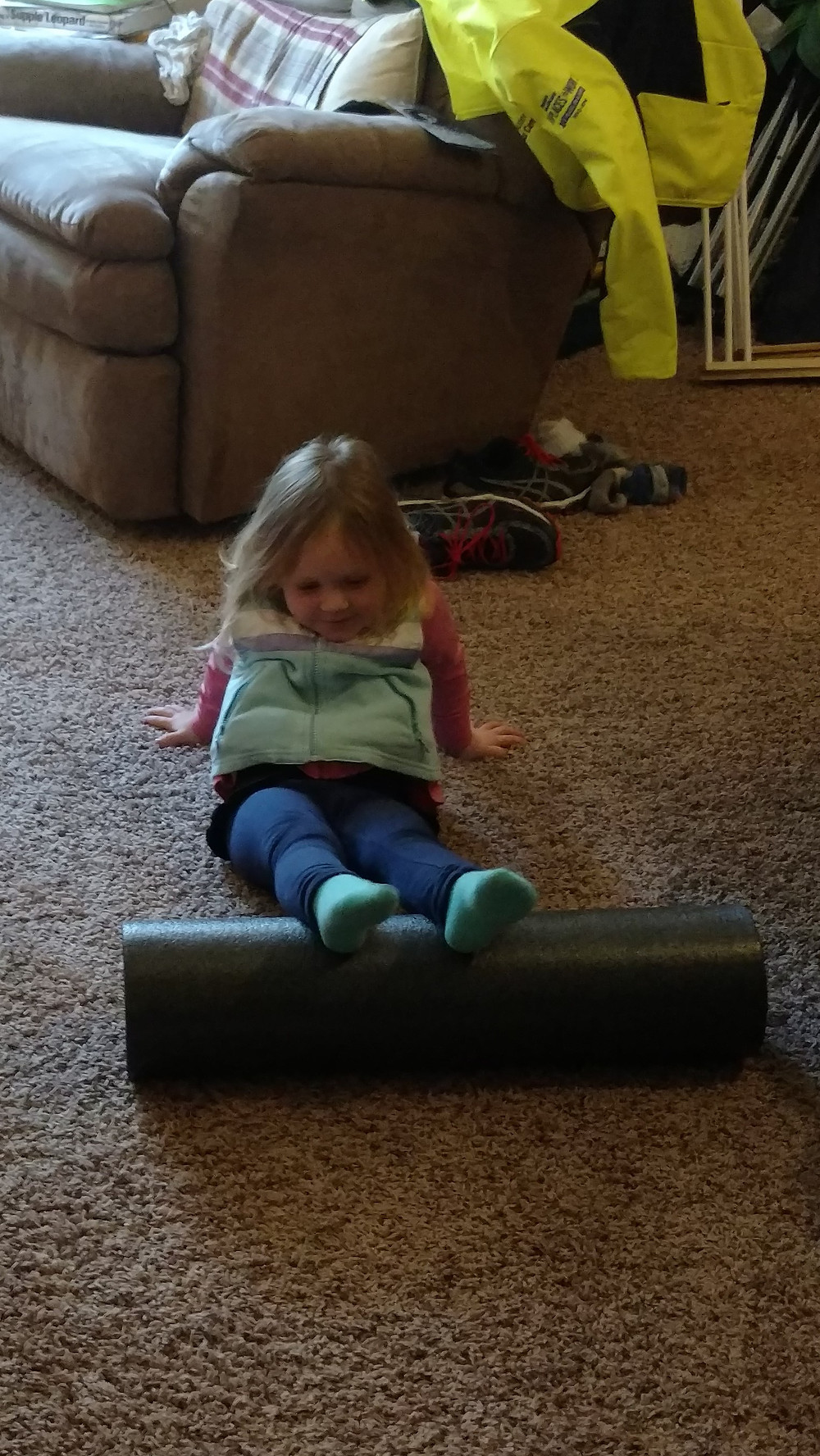 Lucy foam rolling at age 3
