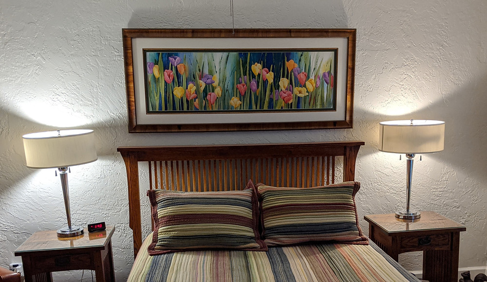 The bedroom focal point is an Original watercolor colorful tulips by Kate Moynihan artist