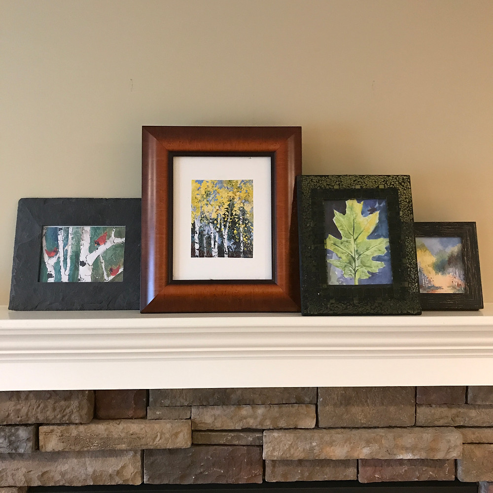Leaning frames on shelf with Giclee leaf prints by Kate Moynihan
