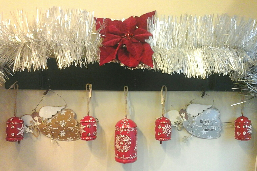 Christmas mantel with monochromatic red as one color home decor accent