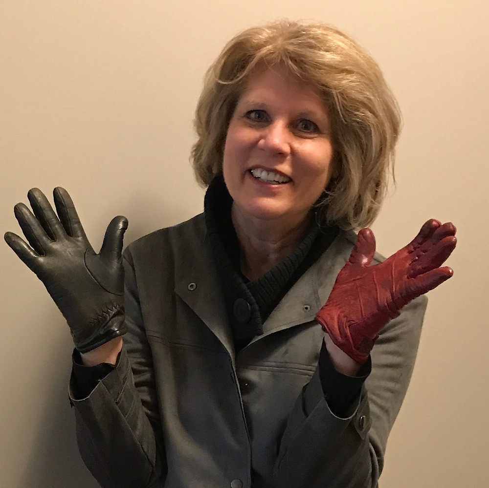 Kate Moynihan artist, sometimes accidentally wearing one red, one black glove