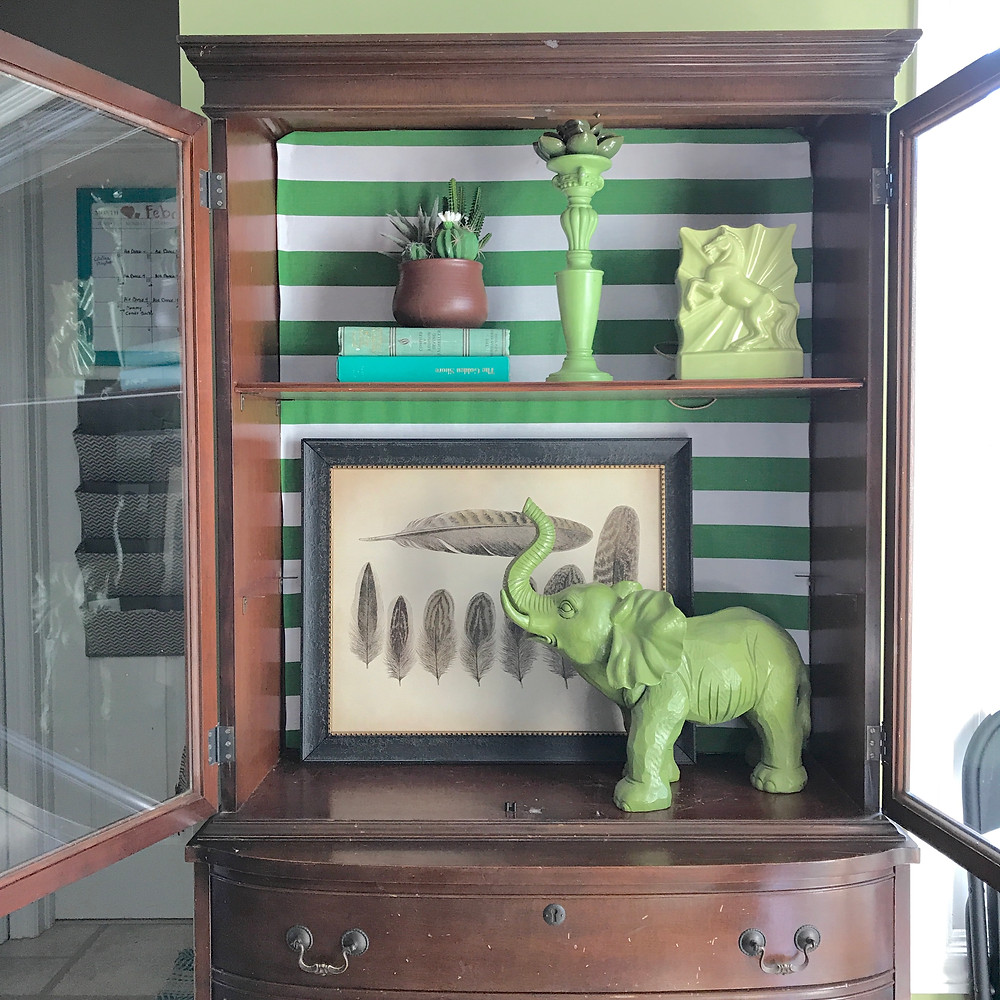 Brown hutch with green accessories home of Lindsay Moynihan