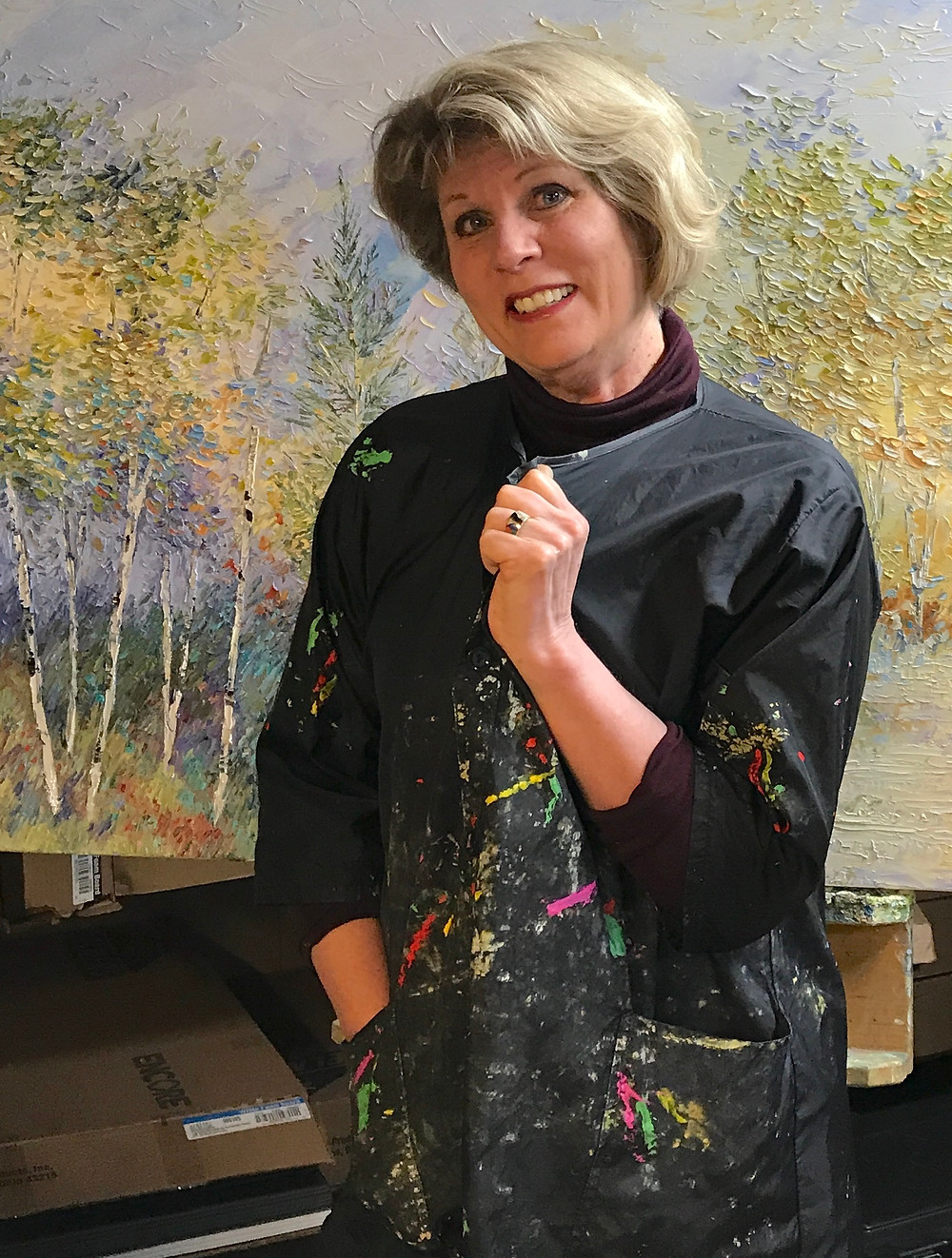 Kate Moynihan artist wearing painterly smock which builds confidence