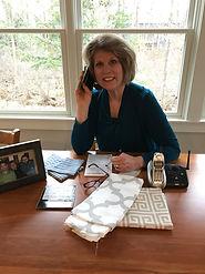 Kate on phone desk.JPG