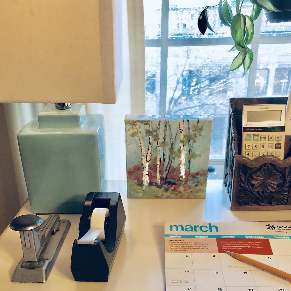 Small birch landscape original acrylic by Kate Moynihan artist on desk of Marquerite Schroeder