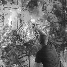 Applying the second layer of a wall mural