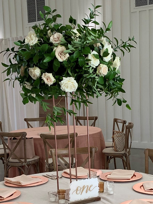 Tall greenery and rose centerpiece