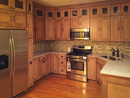 Kitchen with two high upper cabinets.jpg