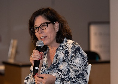 Producer Martha Sosa talks to a full house at Tucson Cine Mexico's 2019 Opening Night Party. March 2019