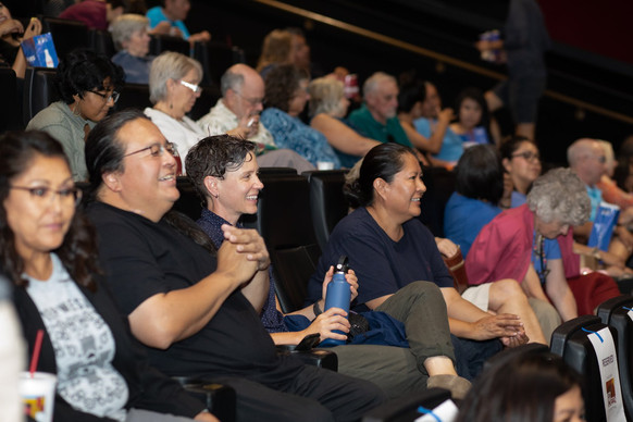 Audience members take their seats for Flagstaff Red Screen Film Festival's Tribute to Jake Hoyungowa and Focus on Navajo Filmmakers. July 2019  Photo by Steven Toya