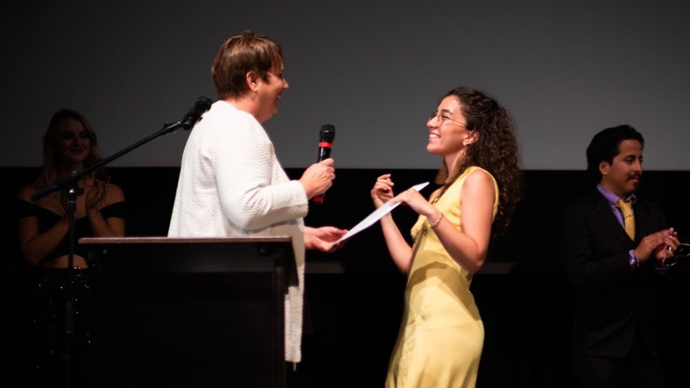 Tasnim Boufelfel is presented the Production Design award by the Hanson FilmTV Institute former director Vicky Westover at I Dream in Widescreen. April 2019