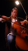 Cello, cellist in a dark studio