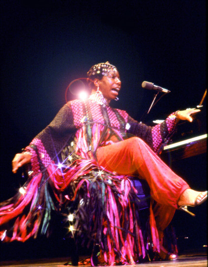 Nina Simone on stage during a concert at the Beacon Theater in New York City. C. 1973