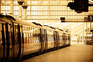 Train on platform in station in London.j