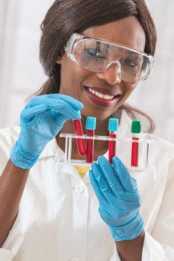 Female lab technologist at uq