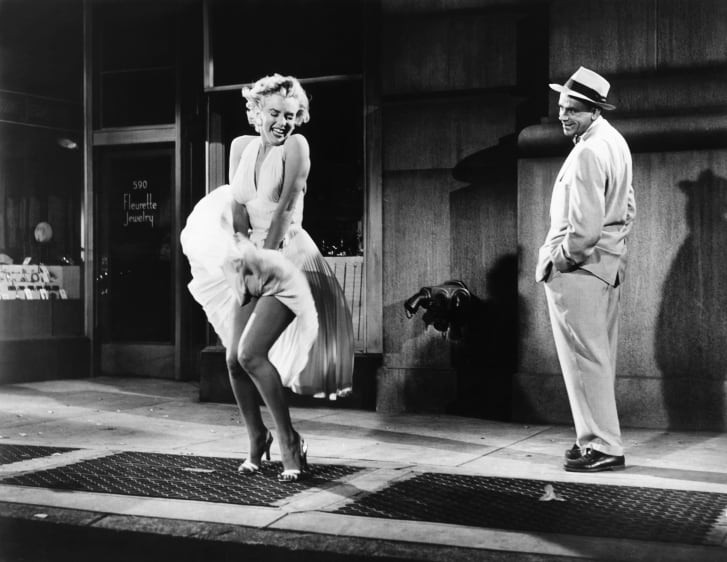 """Actress Marilyn Monroe and actor Tom Ewell on the set of """"The Seven Year Itch."""""""