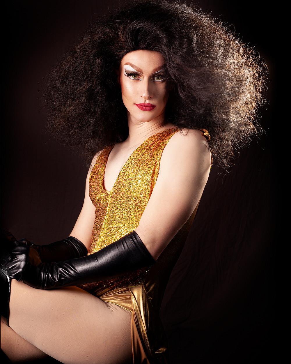 Drag Queen, yellow bodysuit and black gloves