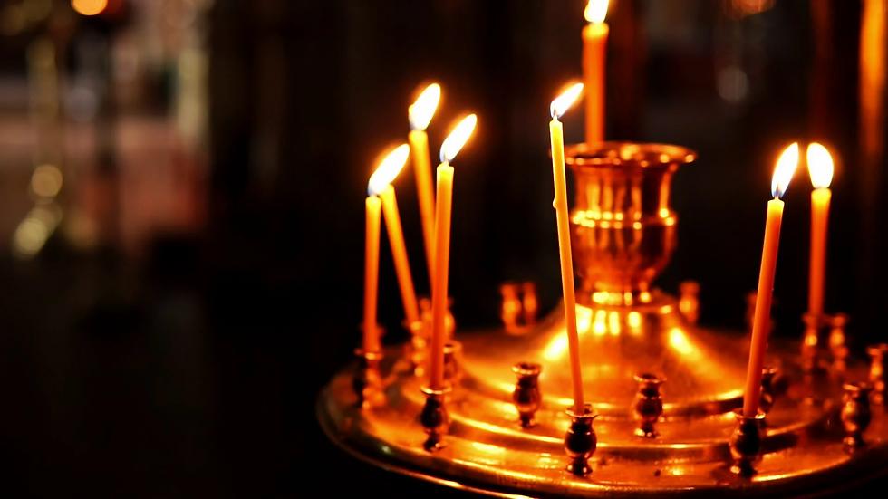 golden-orthodox-candle-holder-burning-fo