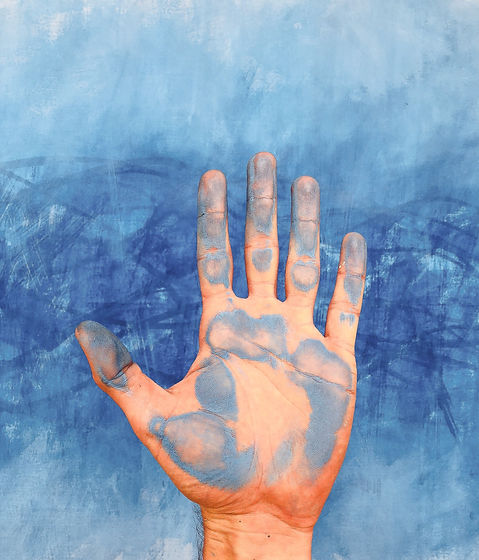 persons-left-hand-on-blue-textile-368977
