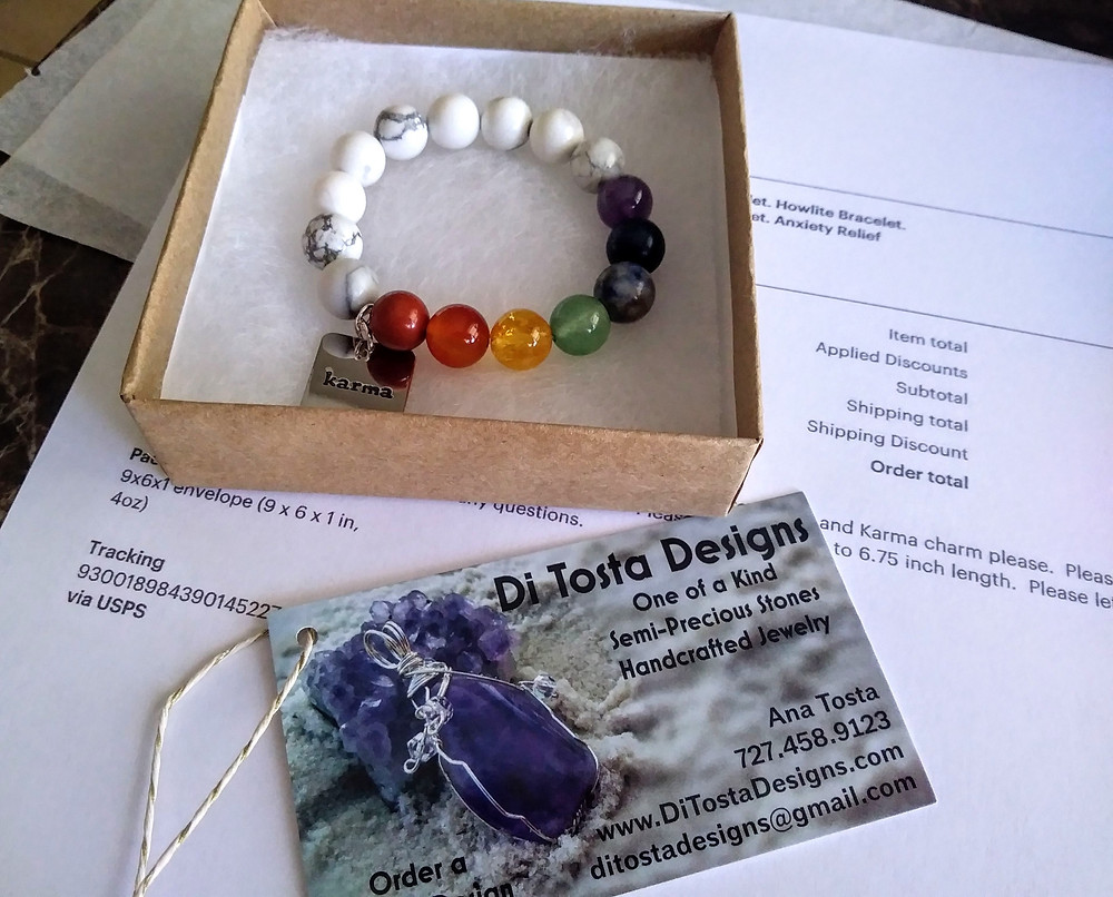 ana ditostadesigns preparing a package for shipping.