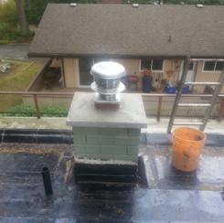 Single flue with boiler venting and rain-cap.jpg