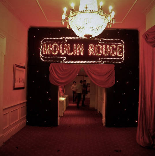 Moulin Rouge Sign and Star Cloth on Goal