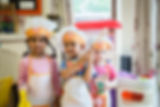 Children playing at nursery being cooks