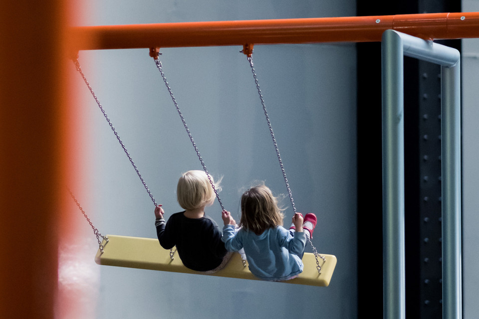 Two Kids Swinging with back to the camera