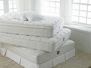 Bassett Bedding Firm Plush UltrPlush matresses in a stack