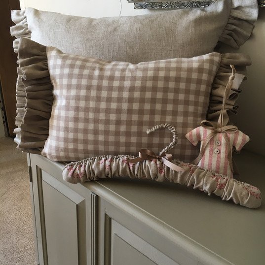 Large frilled cushions, clothes hanger and lavender dress decorations