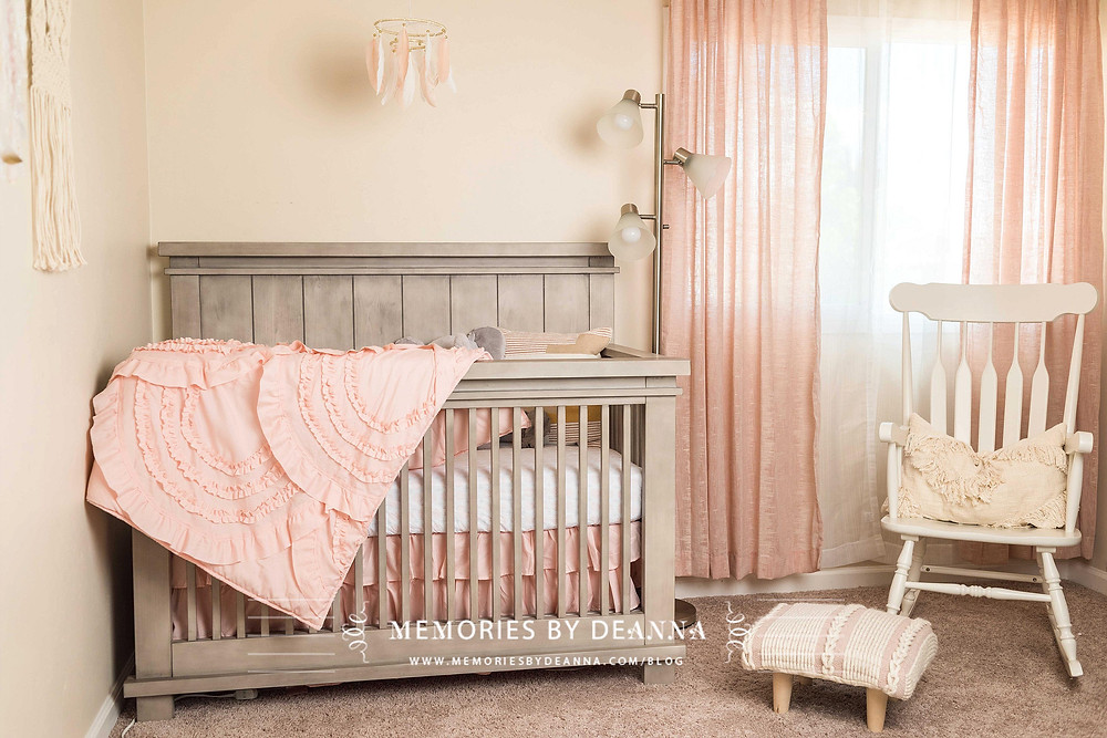 Beautiful baby girl nursery decorated with blush pink and neutrals, and macrame wall hangings.